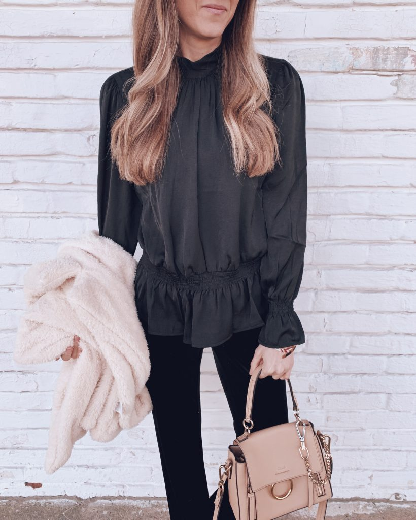 all black chic comfortable holiday christmas party outfit